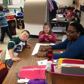 Mason and Paige at work with Miss Jess