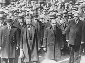 Sacco and Venzetti being escorted to the Court House