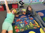 """Nicole and her buddy having fun with the """"Bugs and Butterfly"""" backpack"""