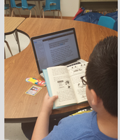 "One of my students using Bookshare!  He's reading ""The Diary of a Whimpy Kid""."