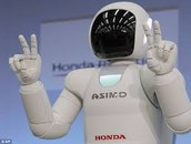 Asimo shows that he is friendly by showing the peace sign