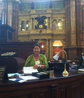 Angela behind the desk in the main reading room