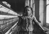 Young girl working in a textile company