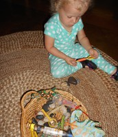 Sophia inspecting the geckos