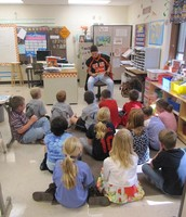High School Football players read to our students!