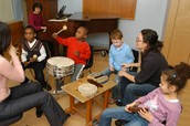 A music therapy session in a group.