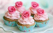 venella cupcake with pink icing with pink flowers