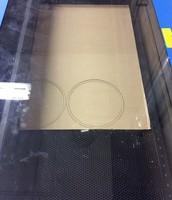 Laser cutter cutting the cardboard