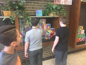 Students displaying their artwork for Open House.