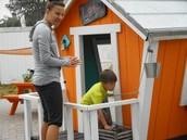 John and Mommy exploring the wacky houses.