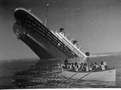 The Titanic sinking after she hit the iceburge.