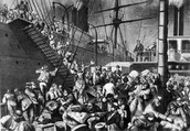 Immigrants getting on a boat to America.