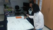 Ms. Nguyen's students work collaboratively with giant white boards