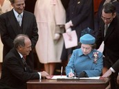 Queen Elizabeth II signing the proclamation of the constitution in 1982.
