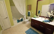 Garden tubs and Mahogany Cabinetry in Your Spacious Bathroom!