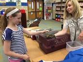 The Creature Teacher with iguana