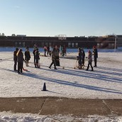 Broomball outside in PE for our 7th and 8th graders