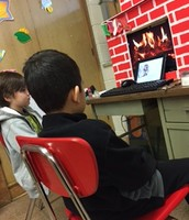Second grade listening to the Grinch by the fire!