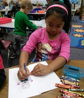Yailet works hard on her Gingerbread emergent reader!