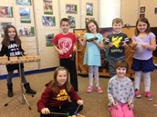 Second Graders play animal instruments  in I Bought Me a Cat!