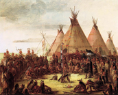 A tribe in front of some tipis