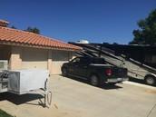 36 feet of RV parking, 3car garage, 12*34 feet pad