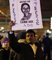 (Man protesting about Tamir Rice Case)