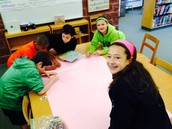 Fifth graders work on author welcome poster