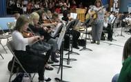 I also teach instrumental music in public schools.