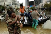 8 people getting on a boat and getting away from Hurricane Katrina