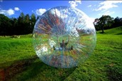 1) Go zorbing in New Zealand with my family