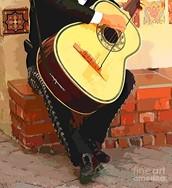 """Fausto getting his guitar"""