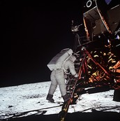 Buzz Aldrin stepping onto the Moon