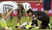 US team player Morgan Brian on the ground after a head collision with another player