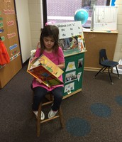 Students reading in front of the class