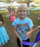 Lucas doing scissor hands