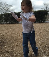 Caroline makes sock puppets at recess.