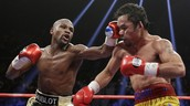 Mayweather finally fights Pacquiao in the fight of the century