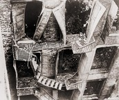 Staircases on the fire escapes collapse under weight of escapees.