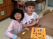 Learning addition by playing Five In A Row!