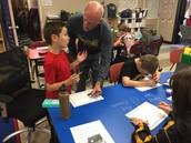 Mr. Marker working with Dawson.