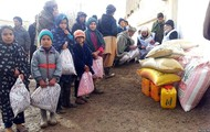 Afghanistan children getting food, blankets, and clothing