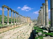 A pathway with pillars on both sides,