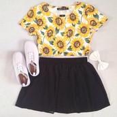daisy t-shirt; black high wasted skirt; white vans