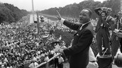 MLK Smiles and Waves at Crowd