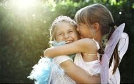 Two young girls sharing a hug