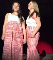 Jade and Kenzie are modeling their matching maxi dresses.