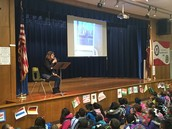 The amazing Ms. Barrett leads our Panthers in a read aloud at W.A.R.P. Wednesday morning assembly!