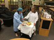 Dr. Butler and Dr. France doing their very best to rescue books that haven't been cared for!