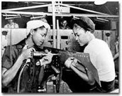 women working on car parts